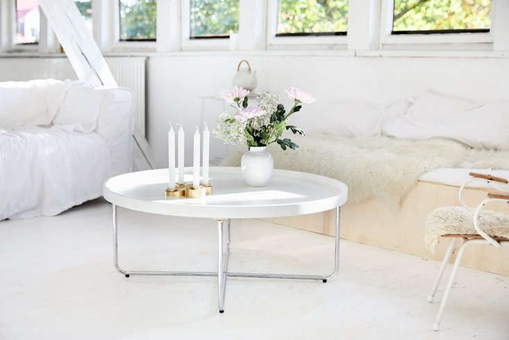 The new coffee table is a round design from the seventies. The white loveseat is theKlippan from Ikea with a slipcover that gets washed several times a month: &#8