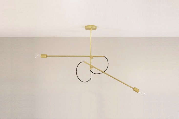 TheDouble Arm Brass Chandelier from Long Made Co. is $375. For more, see Lighting: The New Industrialists.