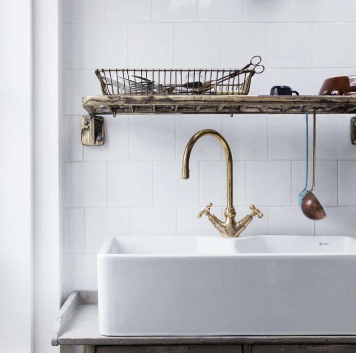 the solid bronze draining rack by lewis hangs above the sink for drying small b 13