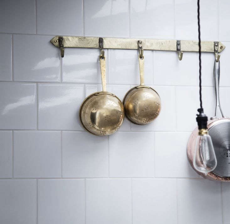 the solid brass pan rack comes in cast bronze or cast brass; £95 (\$\1\26) at  12