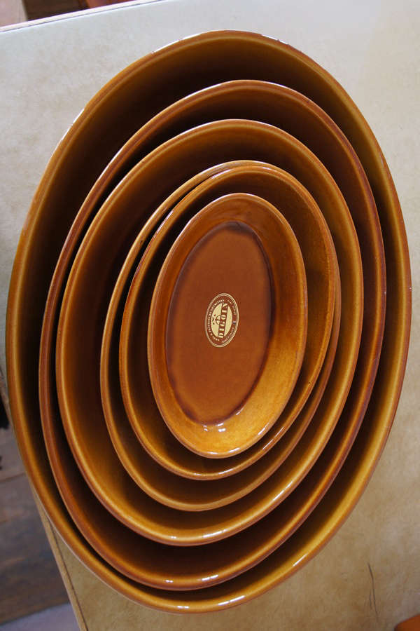We like the rich ochre color of thePlat Sabot fromManufacture de Digoin, the oldest pottery in the Loire Valley; they&#8