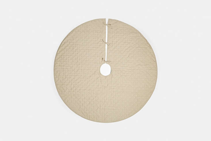 The Cross Stitch Tree Skirt is made of linen with cotton threading and polyester fill; $4 (down from $9) from Rejuvenation Hardware.