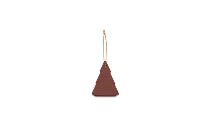 Danish company Skagerak makes the Spruce Tree Decoration in brown (shown) and green from ash wood and leather; $.50 at Connox.