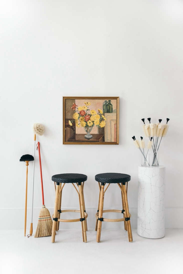utilitarian brooms and brushes on display. 14