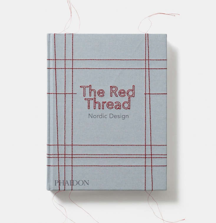 The Red Thread: Nordic Design is covered in blue fabric with red stitching; it&#8