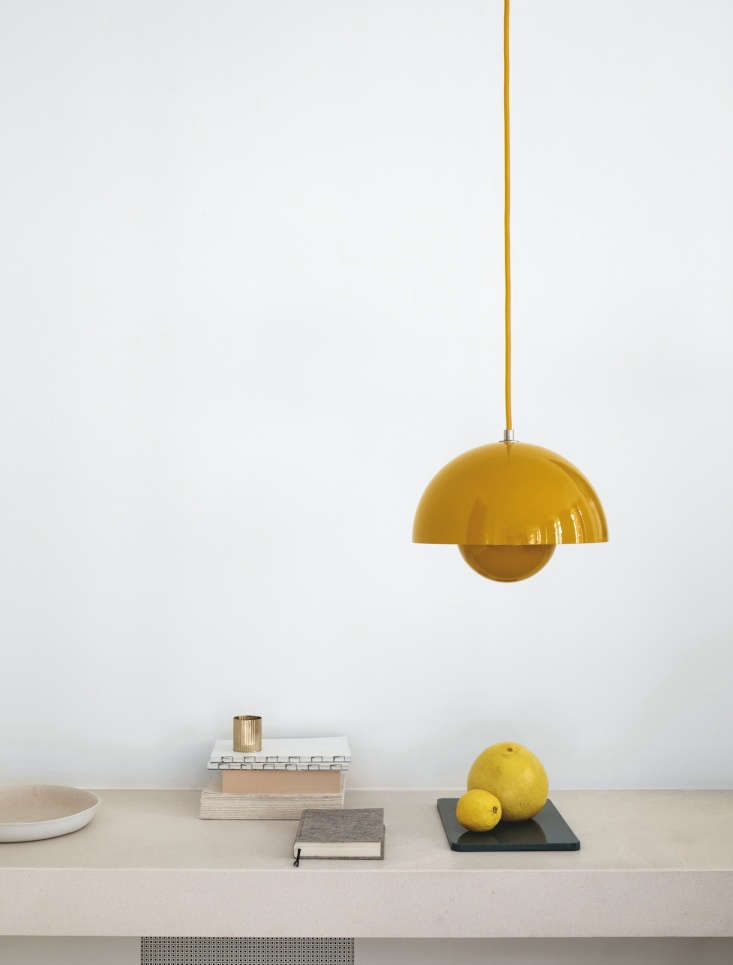 The Flowerpot pendant by Verner Panton, shown in mustard yellow.