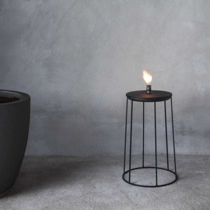 Inspired by a visit to a Japanese garden in LA, the powder-coated steelWire Disc Oil Lamp by Norm Architects is $89.90 from YLiving.