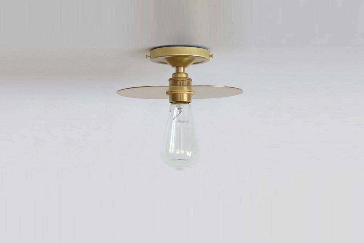 An upgrade to the simple ceiling fixture: the aptly-named Simple but Elegant Brass Reflector Ceiling Light; €8 ($6.06).