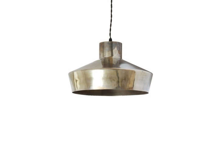 We like the sculptural shape of the handmade Simple Pendant Light, shown here in patinated silver; €306, or $366.0