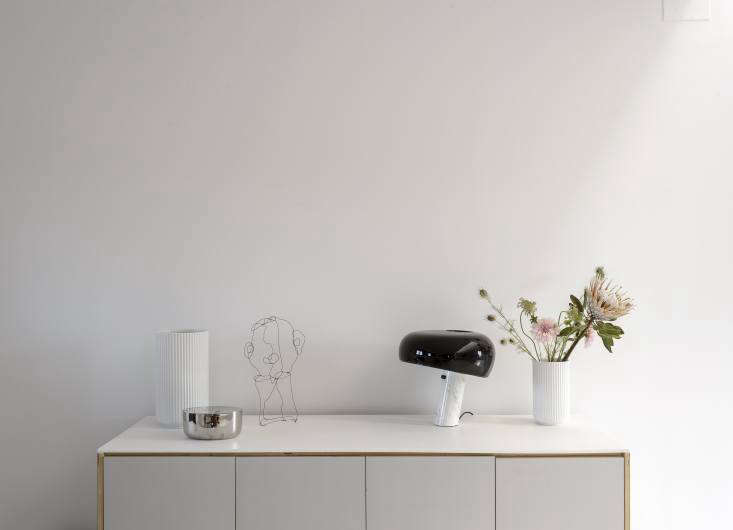 the sideboard, like the kitchen cabinets, is an ikea hack. it displays fluted 13