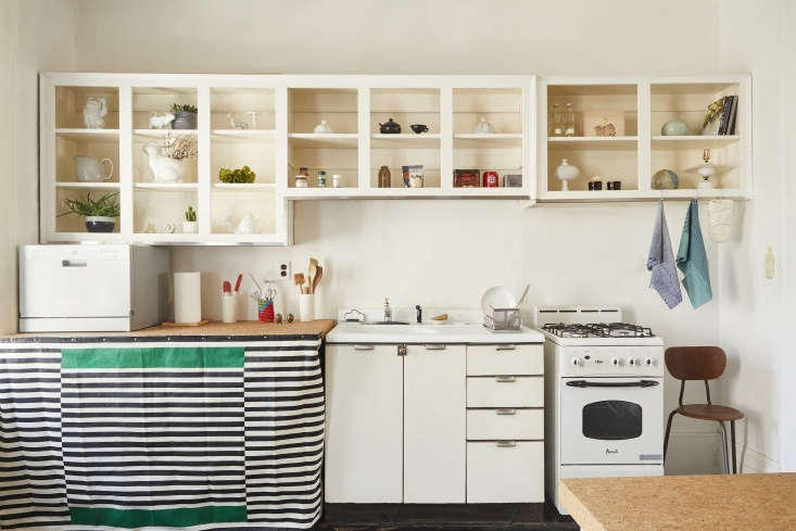 """Valentin modified the kitchen with a few clever interventions, including a cork countertop repurposed from an Ikea Sinnerlig table. He added an SPT Countertop Dishwasher;""""It's not permanently plugged into a pipe,&#8"""