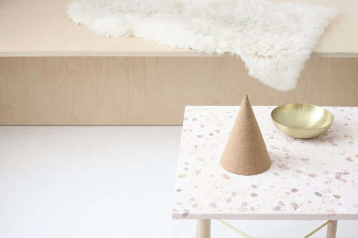 The tabletop is a mix of cement, sand, and grout inset with colored tile fragments.