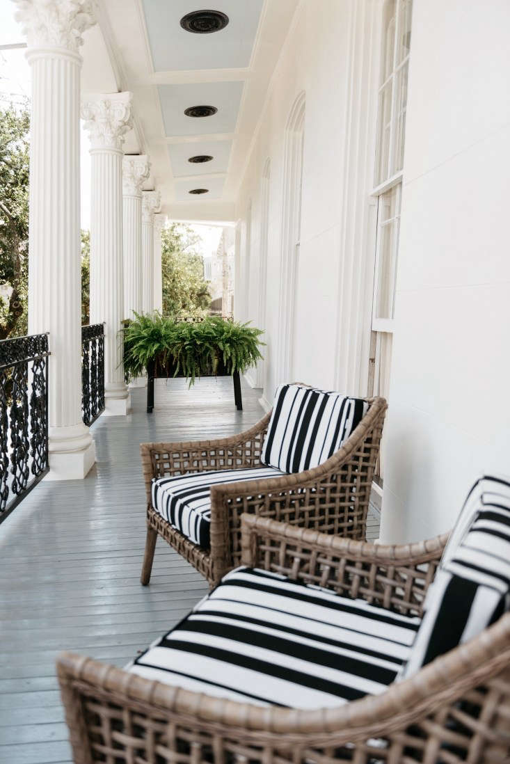 henry hall hotel new orleans exterior black white chair porch