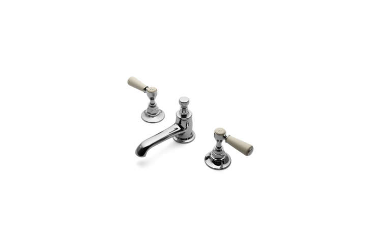 The Waterworks Low Profile Three Hole Deck Mounted Lavatory Faucet has white porcelain lever handles; $69loading=