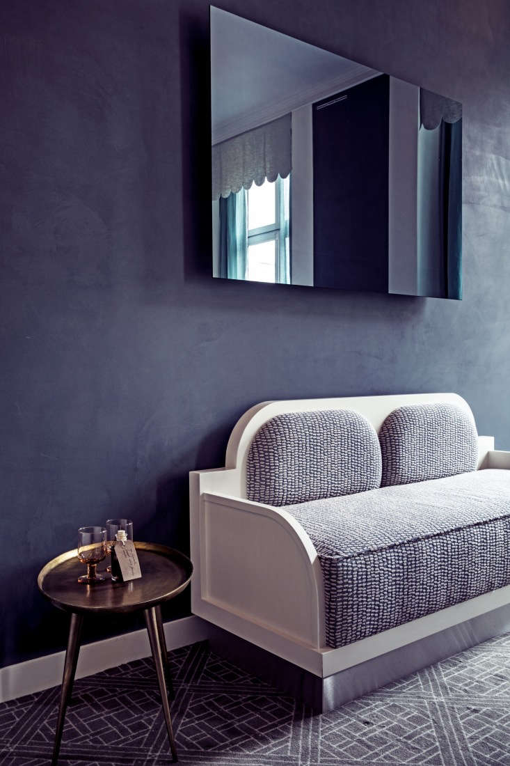 a meilichzon designed banquette in one of the large guest rooms. 24