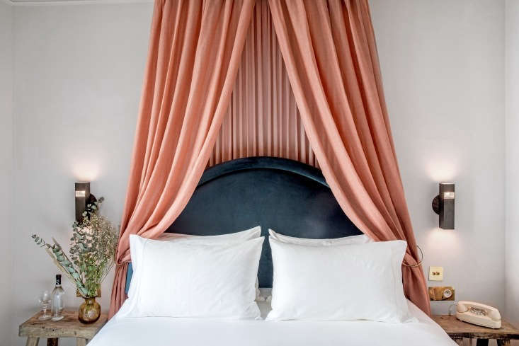 The wool-velvet headboards and cascading canopies are a play on classic French baldachin designs. &#8