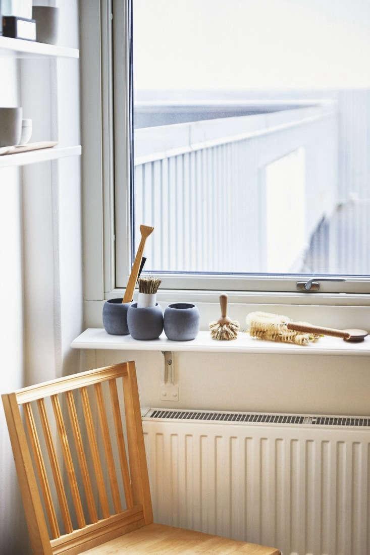 on the windowsill, a trio of soft concrete grey bowls designed for the bathroom. 18