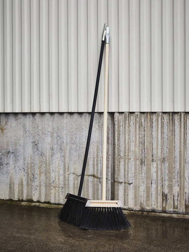 a pair of new brooms designed with black bristles for the swedish railway compa 21