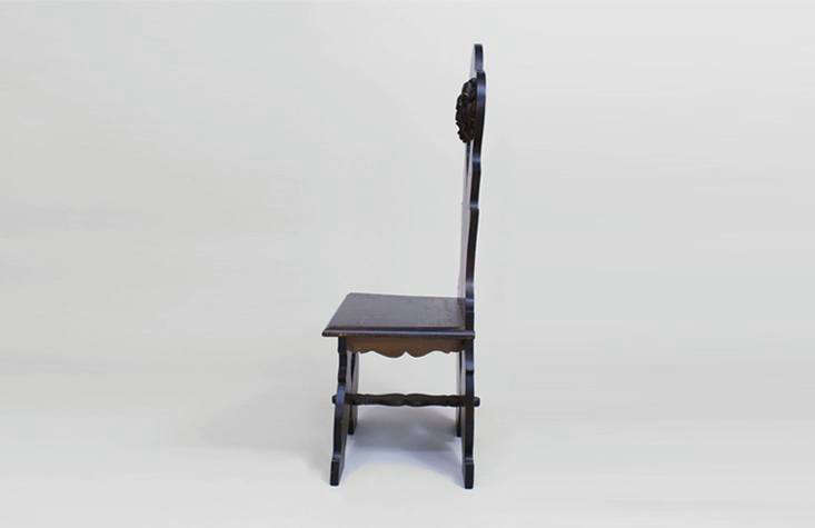 an italian renaissance style sgabello chair in dark wood with carved detailing. 10
