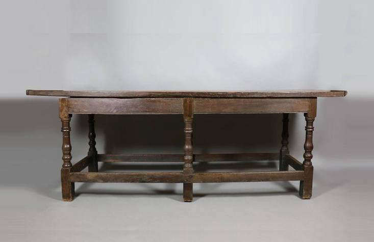 Online antiques retailers offer a selection of early furniture and reproductions, like this heavy Jacobean Oak Refectory Table, estimated from around 00 in England, from loading=
