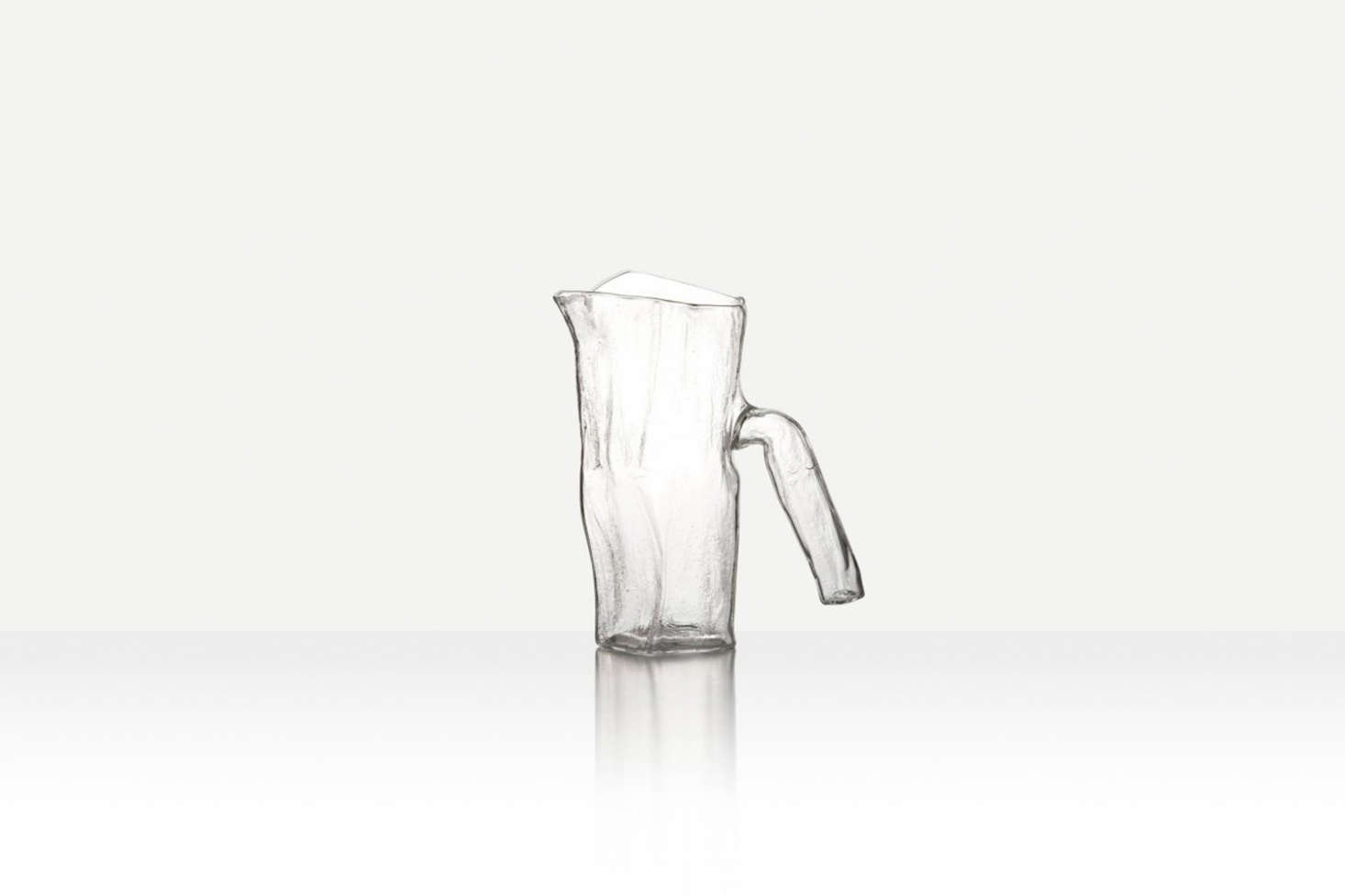The Pressed Textural Jug from Jochen Holtz is free blown from borosilicate and has a textural pressed interior; it&#8