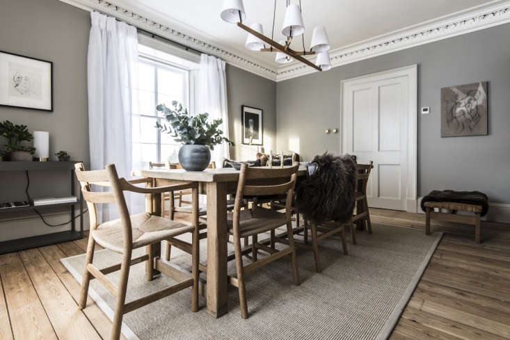 Dinner is typically served at one of two long, Danish dining tables—one in the kitchen and one in the dining room, shown here.