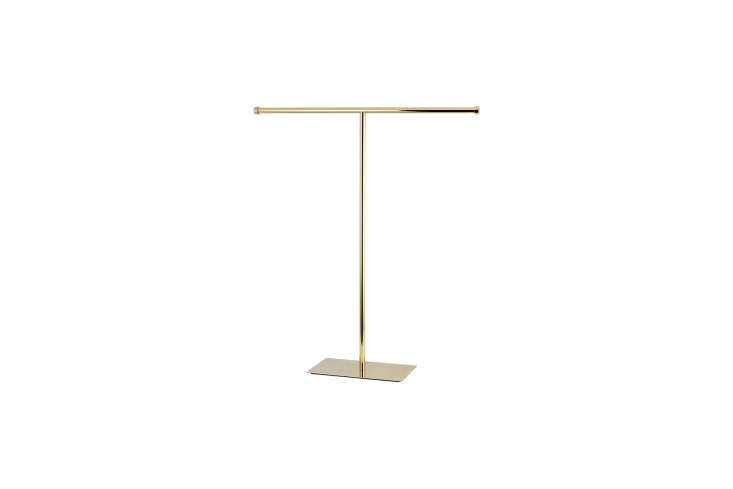The Kingston Brass Claremont Free-Standing Towel Rack in Brass is $loading=