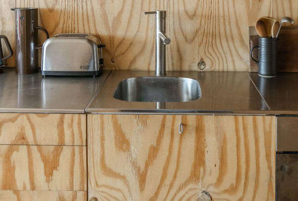 The thin stainless steel countertops and integrated stainless prep sink were originally from Ikea (the company no longer offers a stainless steel worktop option). For more on steel countertops, seeRemodeling src=