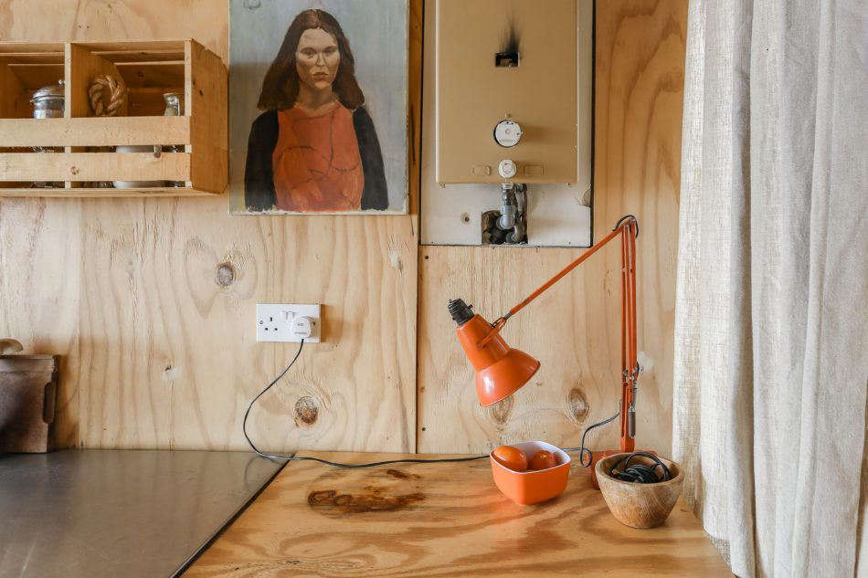 The hut is mostly plywood, but Maria and Durrell incorporate a playful palette of orange, red, and green when they can.Photograph byMarcia MihotichfromTwo London Creatives Shore Up a Tiny Beach House, Ikea Hack Kitchen Included.