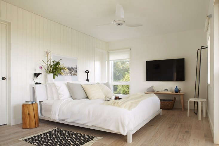 mass cottage bedroom white stained floors shiplap walls