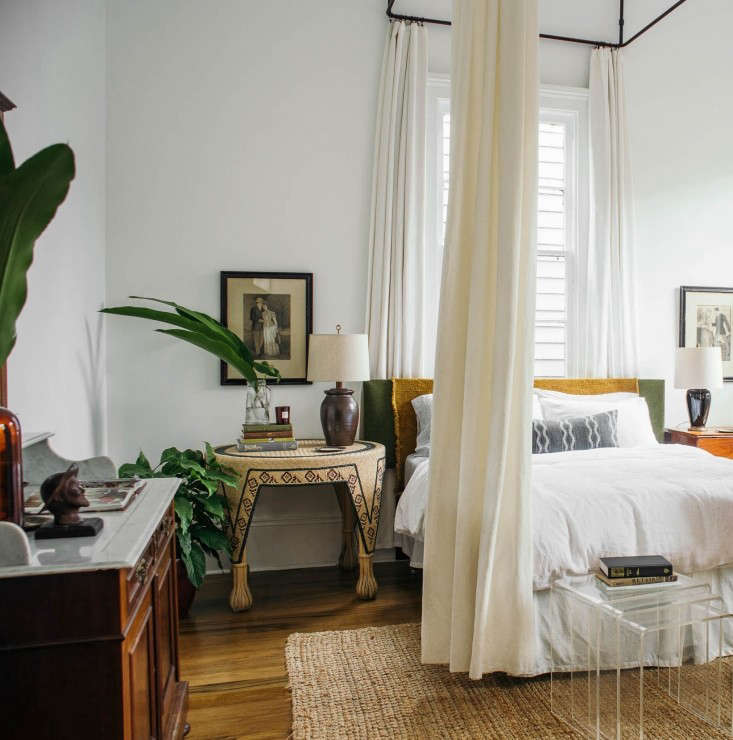 """In the master bedroom, the last room of the house, Rosa found a metalworker to create a dramatic custom canopy out of hollow metal tubing and matching curtain rods. Here, she mixes antique elements with modern:""""I've never felt comfortable just buying a bunch of stuff to fill a room,"""" she says. """"I'd rather work with what I have or what already exists. It's a very intuitive process: Sometimes it's about editing back, or buying old stuff as you're attracted to it, being patient and disciplined."""" Rosa considers herself self-taught, guided by a love for the process: """"This is my play space. I don't take take anything too seriously, nothing is too precious, there are no rules,&#8"""