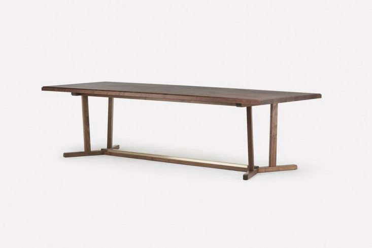 the neri & hu shaker dining table in walnut with a timber top is available  11