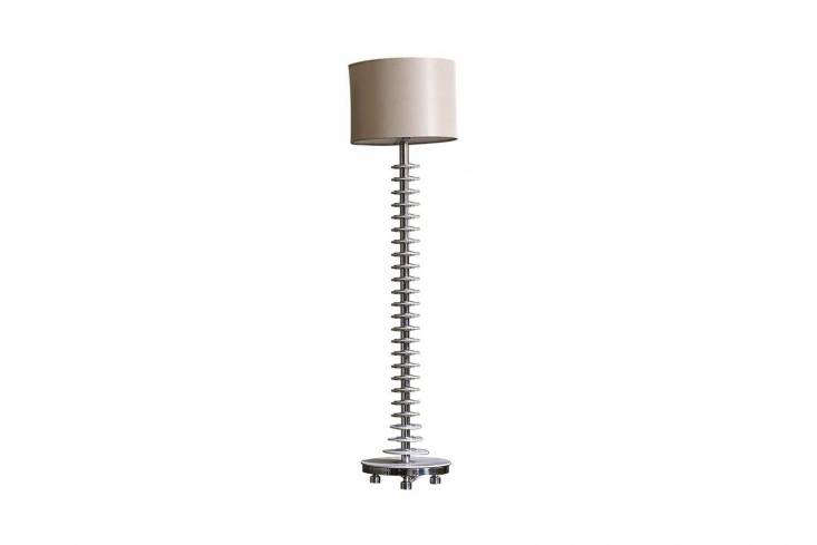 The Ochre Maasai Tall Table Lamp with a burgundy silk shade sits on the kitchen countertop.