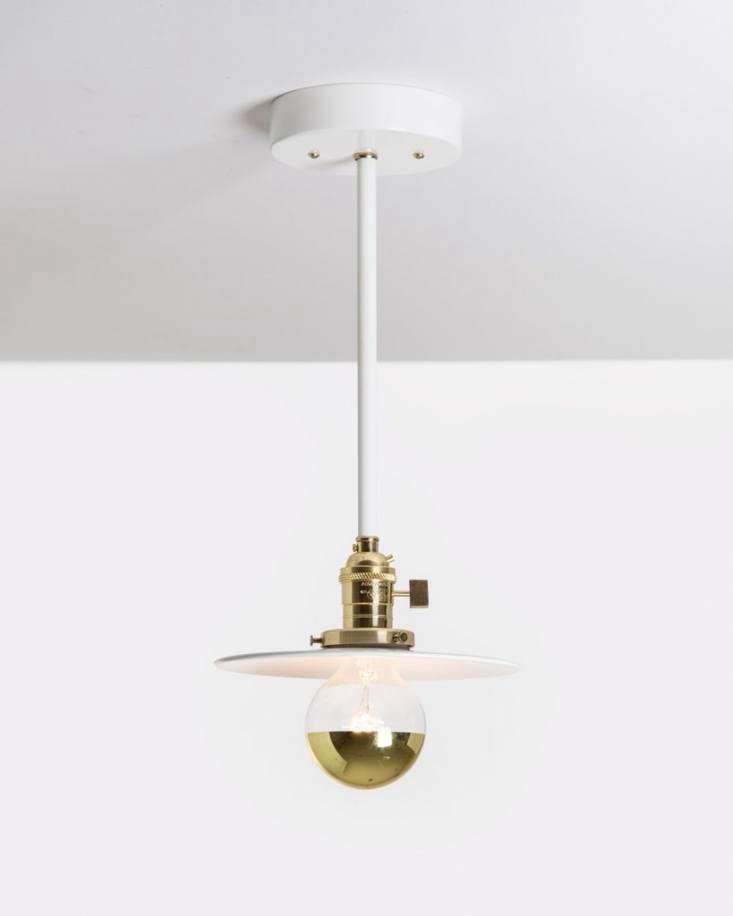 TheOFS. Drop Pendant hangs a petite steel disk from a brass fixture with on/off switch and a -inch white steel rod. It&#8