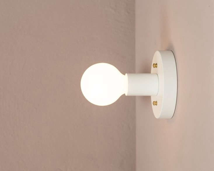 When mounted horizontally, the fixture can be used as a sconce—to light a hallway, closet, or bathroom. The light is five inches in diameter and 3. inches tall.