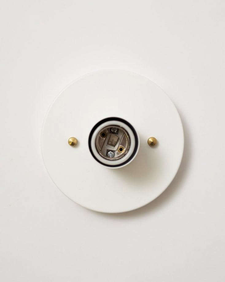 The center of the fixture is a standard E- white ceramic light socket.