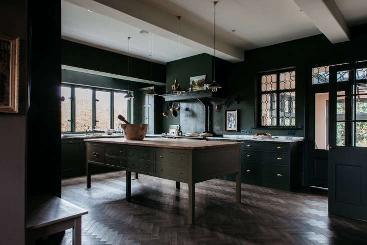The team maintained the original bones of the house, including the leaded windows, flagstone floors, oak-paneled walls, and fireplaces. Then, Plain English set about building out a kitchen that feel as though it&#8