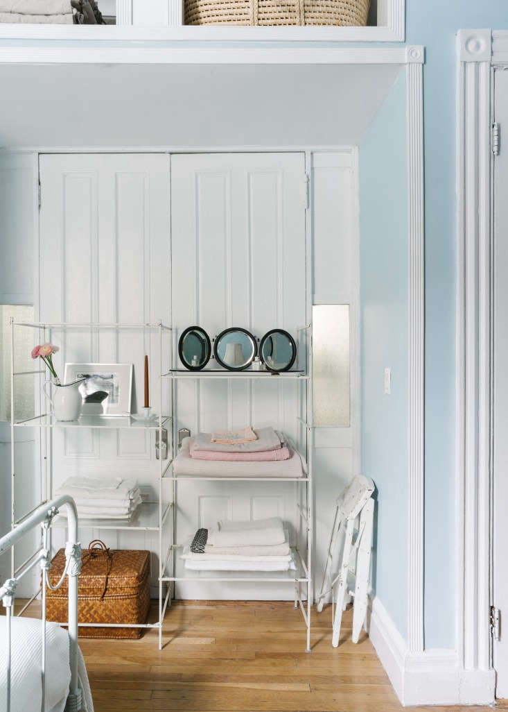 A Modern FairyTale Told in 800 Square Feet Sandeep Salters Family Apartment A glass shelf bought on a whim at ABC Carpet & Home (something similar is the ABC DNA Synthesis Shelf) stores linens in a French door alcove between the bedroom and living room.