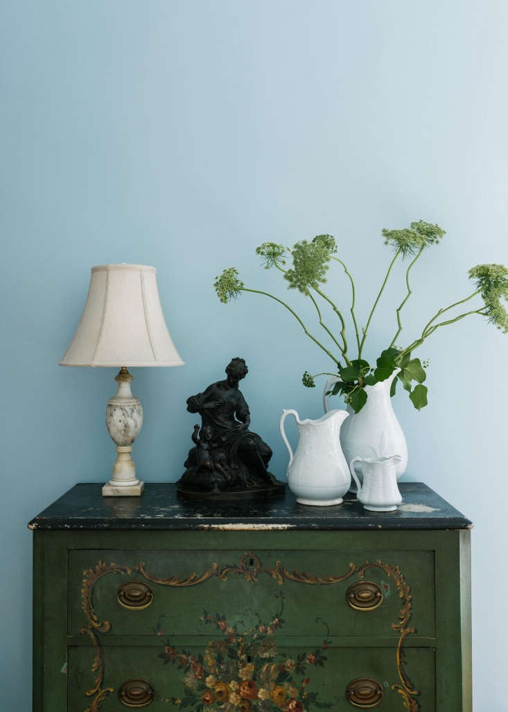 A Modern FairyTale Told in 800 Square Feet Sandeep Salters Family Apartment A marble topped painted dresser from the Salter family collection is paired with Ironstone from Sandeep's grandmother.