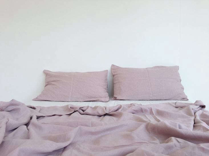 One deviation from the blue-green spectrum: dusty pink Caribbean sheets, an homage to balmier seaside climes.