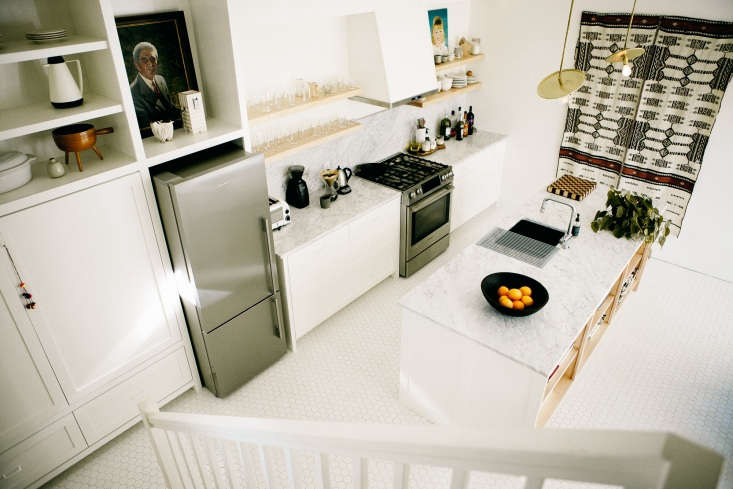 a portrait fills the space above the refrigerator inkitchen of the week: a mo 10
