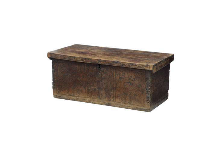 A rough-hewn Continental Fruitwood Marriage Chest Coffer has intricate carvings, from around 00; found via src=
