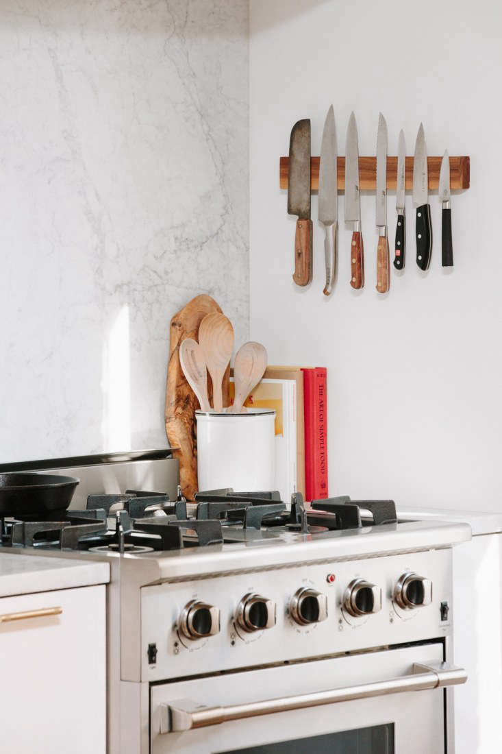Steal This Look A SemiCustom Kitchen in Brooklyns Sunset Park A wall mounted magnetic rack keeps cutlery in line over the compact gas range.Photography by and courtesy ofSpace Exploration.