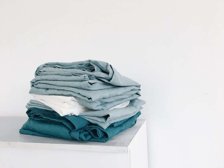 A stack of the linens in sea-inspired hues.