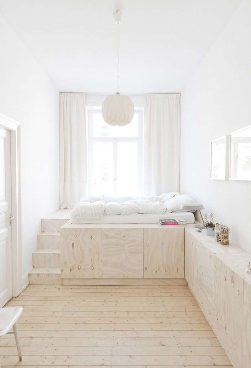 This Studio Oink-designed plywood platform bed in Wiesbaden, Germany, incorporates seamless storage, so there&#8