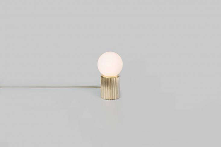 On the counter is theRex Table Lamp in brass from Urban Electric Co.