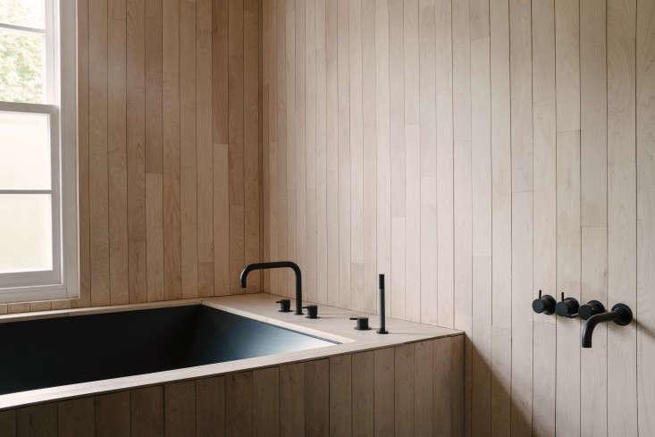 In a th-century London house remodeled by architects Undercover Architecture, a black ceramic bath is tucked inside a shell of Canadian mapletreated with exterior-grade lacquer and natural white oil.Photograph courtesy of Michelle Young, featured inA London Terrace House with Brilliant Color by Undercover Architecture.
