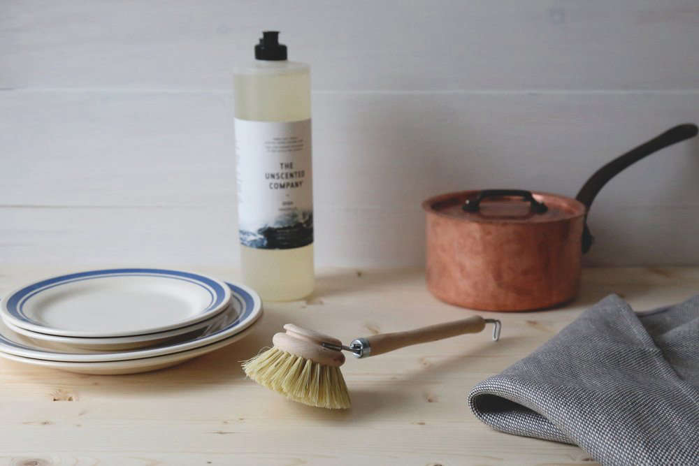 In addition to cleaning solutions, the Unscented Company offers dishcloths and a wood-handled Dish Brush, made in Germany; $8.50 CAD ($6.90 USD).