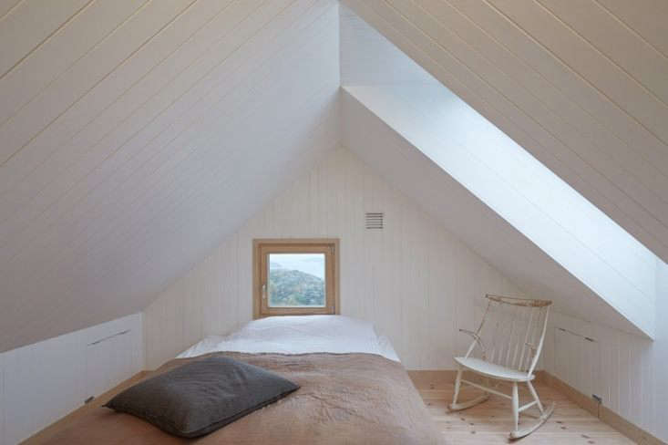 A shiplap-paneled perch on the top floor of a vacation house in Vega, Norway, designed by Kolman Boye Architects. See more in The Outermost House: A Norwegian Island Retreat. Photograph byÅke E:son Lindman, courtesy of Kolman Boye.