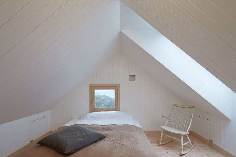 A soothing bedroom in a vacation house in Vega, Norway, designed by Kolman Boye Architects. See more inThe Outermost House: A Norwegian Island Retreat. Photograph byÅke E:son Lindman, courtesy ofKolman Boye Architects.
